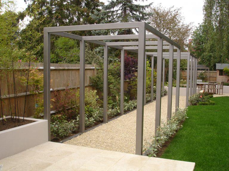 Rupert created a stunning gun metal grey pergola in Esher, Surrey. A  contemporary garden with traditional English country garden planting. - Garden Pergolas Design & Erection - Weybirdge - Surrey